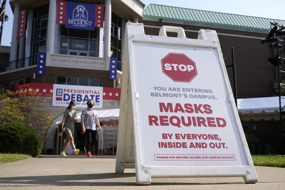 A sign greets visitors outside the Curb Event Center at Belmont University as preparations take place for the second Presidential debate, Tuesday, Oct. 20, 2020, in Nashville, Tenn., during the coronavirus outbreak. Governors of states including Tennessee, Oklahoma, Nebraska and North Dakota are all facing calls from doctors and public health officials to require masks. (AP Photo/Patrick Semansky)