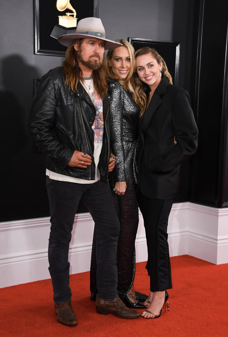 Singer Miley Cyrus (R) poses with her parents Billy Ray Cyrus and Tish Cyrus at the 61st Annual Grammy Awards on February 10, 2019, in Los Angeles. (Photo by VALERIE MACON / AFP via Getty Images)