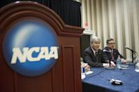 NCAA President Mark Emmert, left, and Division 1 board of directors member Kirk Schulz, Kansas State University president, speak with reporters during a news conference at the NCAA Convention in Oxon Hill, Md., Friday, Jan. 16, 2015. The NCAA announced Friday, a settlement with Penn State that will give the school back 112 wins wiped out during the Jerry Sandusky child molestation scandal and restore the late Joe Paterno as the winningest coach in major college football history. (AP Photo/Cliff Owen)
