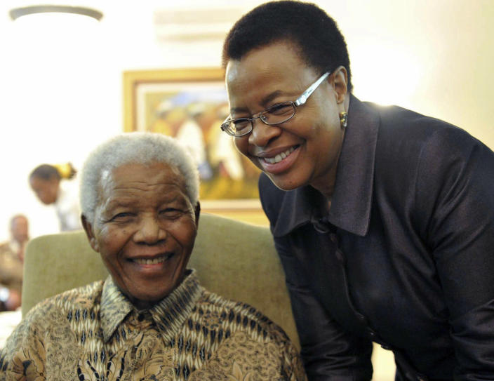 """FILE - May 16, 2011 file photo supplied by the South African Government Communications and Information Services, GCIS, showing former South African President Nelson Mandela and his wife Graca Machel at his home in Johannesburg, South Africa. Mandela was admitted to a hospital on Saturday March 9 2013 for a scheduled medical check-up and doctors say there is no cause for """"alarm,"""" the president's office said. Presidential spokesman Mac Maharaj said 94-year-old Mandela went in the afternoon for tests """"to manage existing conditions in line with his age"""" at a hospital in Pretoria. (AP Photo/Elmond Jiyane-GCIS, File)"""