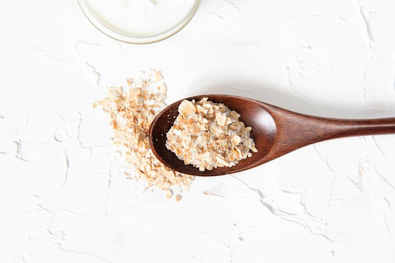 Homemade cosmetics with yogurt and oatmeal on a white background. Ingredients for the mask.