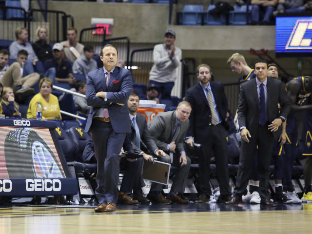 Northern Colorado's Coach Jeff Linder watches from the sidles during the second half of an NCAA college basketball game Monday Nov. 18, 2019, Morgantown, W.Va. (AP Photo/Kathleen Batten)