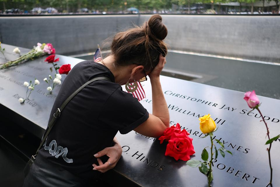 A woman mourns as she visits the 9/11 Memorial on the 20th anniversary of the September 11, 2001 attacks in New York City, New York, U.S., September 11, 2021.  (Amr Alfiky/Reuters)