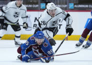 Los Angeles Kings defenseman Sean Walker (26) knocks down Colorado Avalanche left wing Andre Burakovsky (95) during the first period of an NHL hockey game Thursday, May, 13, 2021, in Denver. (AP Photo/Jack Dempsey)