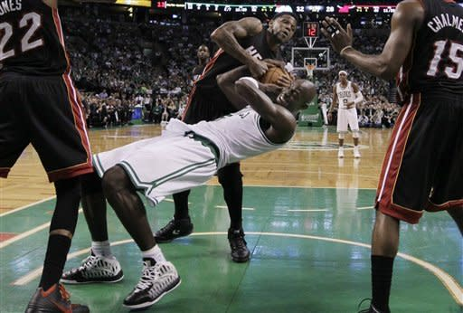 Boston Celtics forward Kevin Garnett (5) bends back as he fights for a rebound with Miami Heat forward Udonis Haslem during the second half of Game 3 in the NBA basketball playoffs Eastern Conference finals, in Boston on Friday, June 1, 2012. (AP Photo/Elise Amendola)