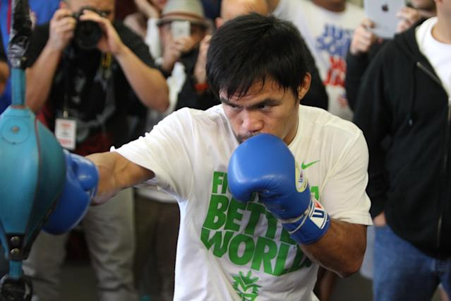 HOLLYWOOD, CA - APRIL 2: Boxer Manny Pacquiao hits the double end bag during his media workout day at the Wild Card Boxing Gym on April 2, 2014 in Hollywood, California (Photo by Alexis Cuarezma/Getty Images)