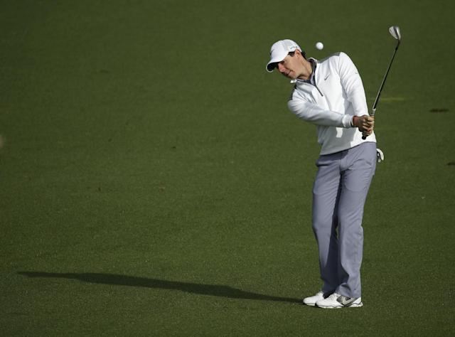 Rory McIlroy, of Northern Ireland, hits to the second green during a practice round for the Masters golf tournament Tuesday, April 8, 2014, in Augusta, Ga. (AP Photo/Charlie Riedel)