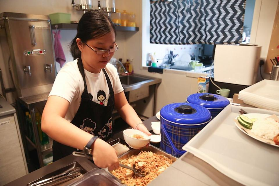 Sue Ann preparing a Nasi Lemak Ayam dish, paired with their signature sambal. — Picture by Choo Choy May
