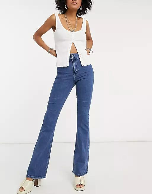 Topshop Three stretch flared jeans in mid blue