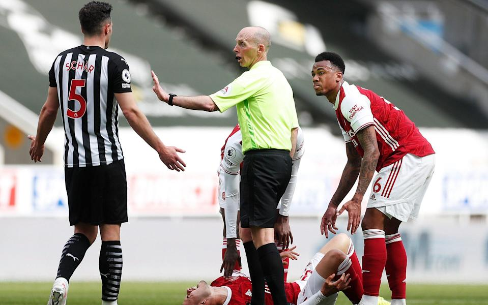 Fabian Schar gets his marching orders after a heavy tackle on Gabriel Martinelli - GETTY IMAGES