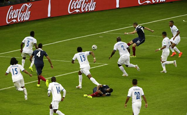 France's Karim Benzema, third right, scores his side's 3rd goal during the group E World Cup soccer match between France and Honduras at the Estadio Beira-Rio in Porto Alegre, Brazil, Sunday, June 15, 2014. (AP Photo/Andrew Medichini)