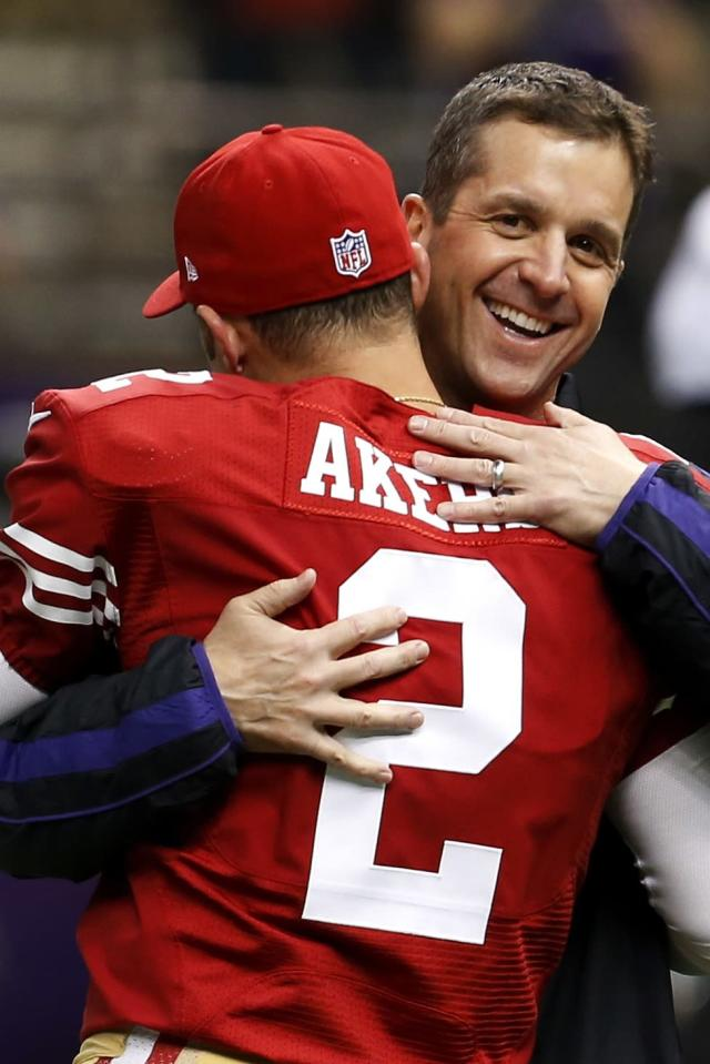 Baltimore Ravens head coach John Harbaugh hugs San Francisco 49ers kicker David Akers (2) before the NFL Super Bowl XLVII football game, Sunday, Feb. 3, 2013, in New Orleans. (AP Photo/Julio Cortez)