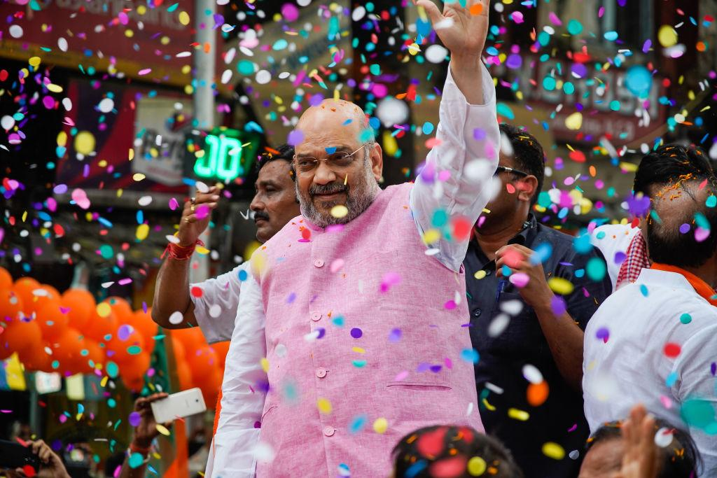 <p>KOLKATA, WEST BENGAL, INDIA – 2019/05/14: BJP or Bharatiya Janata Party national president Amit Shah seen waving to his supporters during the Show in Kolkata.<br />Bharatiya Janata Party (BJP) president Amit Shah on Tuesday held a mega roadshow in Kolkata with support of party's candidates ahead of the final phase of Lok Sabha polls. (Photo by Avijit Ghosh/SOPA Images/LightRocket via Getty Images) </p>