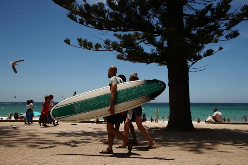 Swimmers, surfers and families flock to Manly beach, just a short ferry ride from the Sydney CBD. Photo: Getty