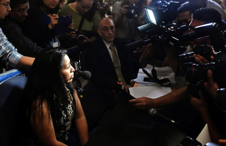 """Teodora del Carmen Vasquez (L) is hounded by the press during a hearing in San Salvador to review her 2008 sentence to 30 years of prison after she was found guilty of """"aggravated homicide"""" for a miscarriage under El Salvador's anti-abortion laws (AFP Photo/OSCAR RIVERA)"""