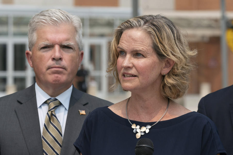 Nassau County Executive Laura Curran, right, speaks at a news conference to discuss a settlement in an opioid trial, Tuesday, July 20, 2021, in Central Islip, N.Y. Suffolk County Executive Steve Bellone is behind her. New York State reached an agreement Tuesday with the distribution companies AmerisourceBergen, Cardinal Health and McKesson to settle an ongoing trial. That deal alone would generate more than $1 billion to abate the damage done by opioids there. The trial is expected to continue, but the settlement leaves only three drug manufacturers as defendants. (AP Photo/Mark Lennihan)