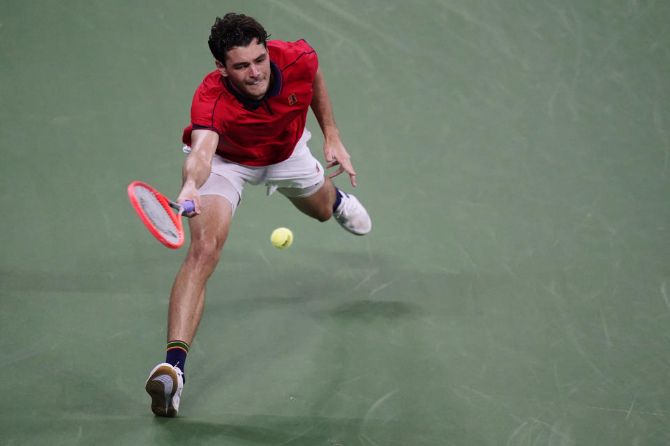 Taylor Fritz, of the United States, returns the ball during the first round of the US Open tennis championships, Tuesday, Aug. 31, 2021, in New York. (AP Photo/Frank Franklin II)