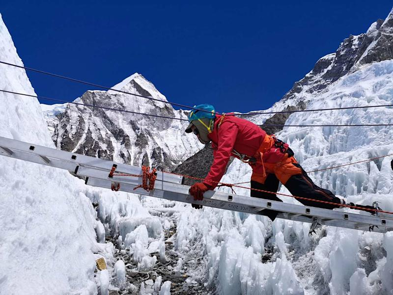 Xia Boyu crosses a ladder in the Khumbu Icefall in May.