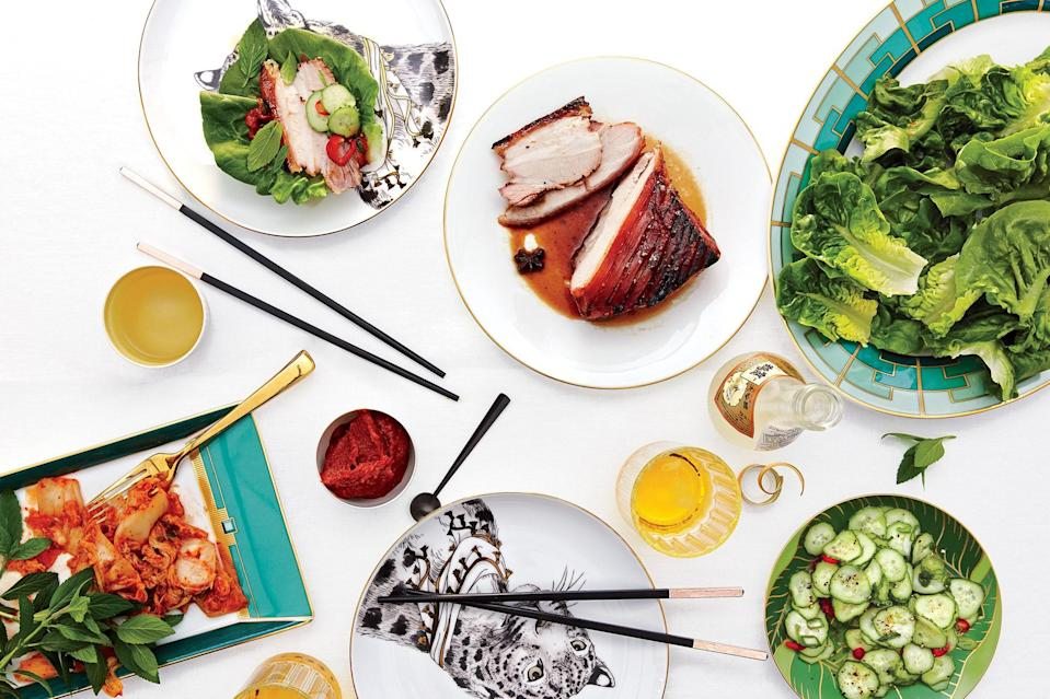 """These sweet and spicy pork belly lettuce wraps are heaven on a hot night, especially when served with a cool, crunchy cucumber salad. <a href=""""https://www.epicurious.com/recipes/food/views/crispy-pork-lettuce-wraps-with-spicy-cucumbers-56390119?mbid=synd_yahoo_rss"""" rel=""""nofollow noopener"""" target=""""_blank"""" data-ylk=""""slk:See recipe."""" class=""""link rapid-noclick-resp"""">See recipe.</a>"""