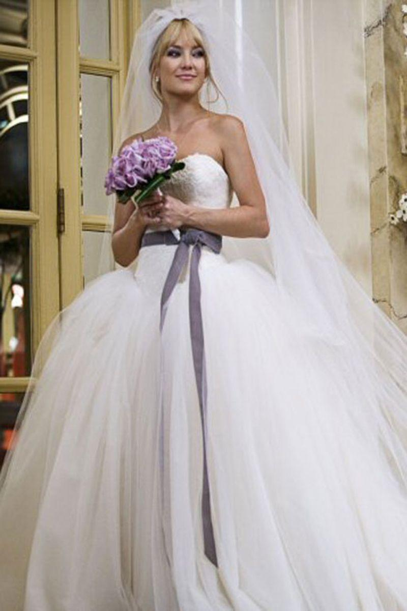 <p>Kate Hudson is one lucky girl. She got to portray Liv, who got married at The Plaza in New York City in <em>this</em> stunning strapless, drop-waist tulle ball gown with a lace bodice and velvet sash.<br></p>