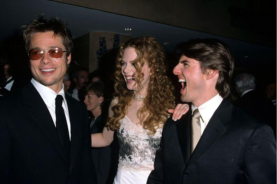 """<p>Pitt cracks up Tom Cruise and then-wife Nicole Kidman in April 1998 at an event honoring the <em>Top Gun</em> star. Cruise and Pitt co-starred in <em>Interview with the Vampire</em> in 1994. In July 2019, Tarantino revealed that Cruise almost nabbed Pitt's role of Cliff Booth in <em>Once Upon a Time in Hollywood </em>on Josh Horowitz's <a href=""""https://podcasts.apple.com/us/podcast/happy-sad-confused/id827905050"""" rel=""""nofollow noopener"""" target=""""_blank"""" data-ylk=""""slk:Happy Sad Confused podcast"""" class=""""link rapid-noclick-resp""""><em>Happy Sad Confused</em> podcast</a>.</p>"""