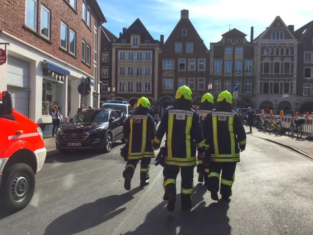 <p>Firefighters walk in downtown Muenster, Germany, Saturday, April 7, 2018. German news agency dpa says several people were killed after car crashes into crowd in the city of Muenster. (Photo: dpa via AP) </p>