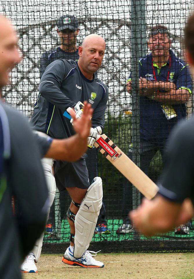 BRIGHTON, ENGLAND - JULY 25:  Darren Lehmann, coach of Australia, bats in the nets as Michael Clarke of Australia and Rod Marsh, Australian Selector, look on during an Australian Training Session at The County Ground on July 25, 2013 in Brighton, England.  (Photo by Ryan Pierse/Getty Images)