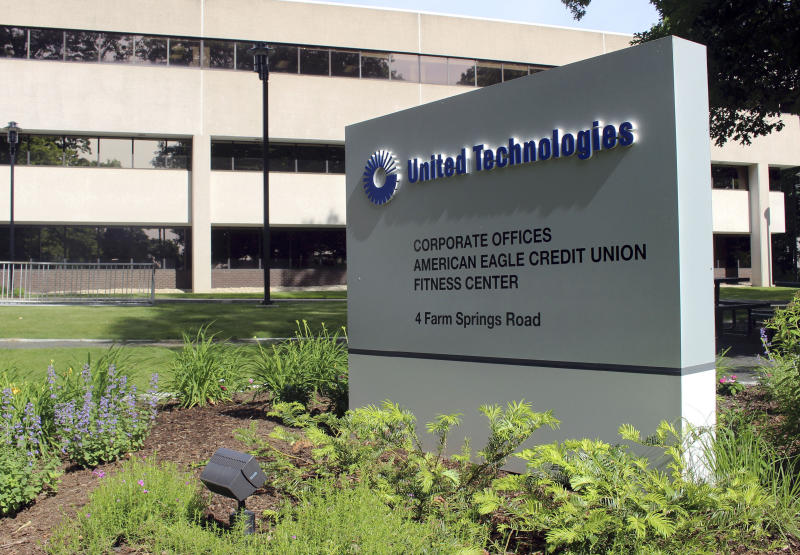 The United Technology headquarters is shown, Monday, June 10, 2019, in Farmington, Conn. Raytheon Co. and United Technologies Corp. are merging in a deal that creates one of the world's largest defense companies. (AP Photo/Pat Eaton-Robb)