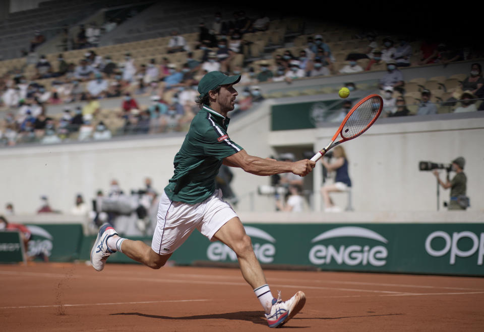 Uruguay's Pablo Cuevas plays a return to Serbia's Novak Djokovic during their second round match on day 5, of the French Open tennis tournament at Roland Garros in Paris, France, Thursday, June 3, 2021. (AP Photo/Christophe Ena)