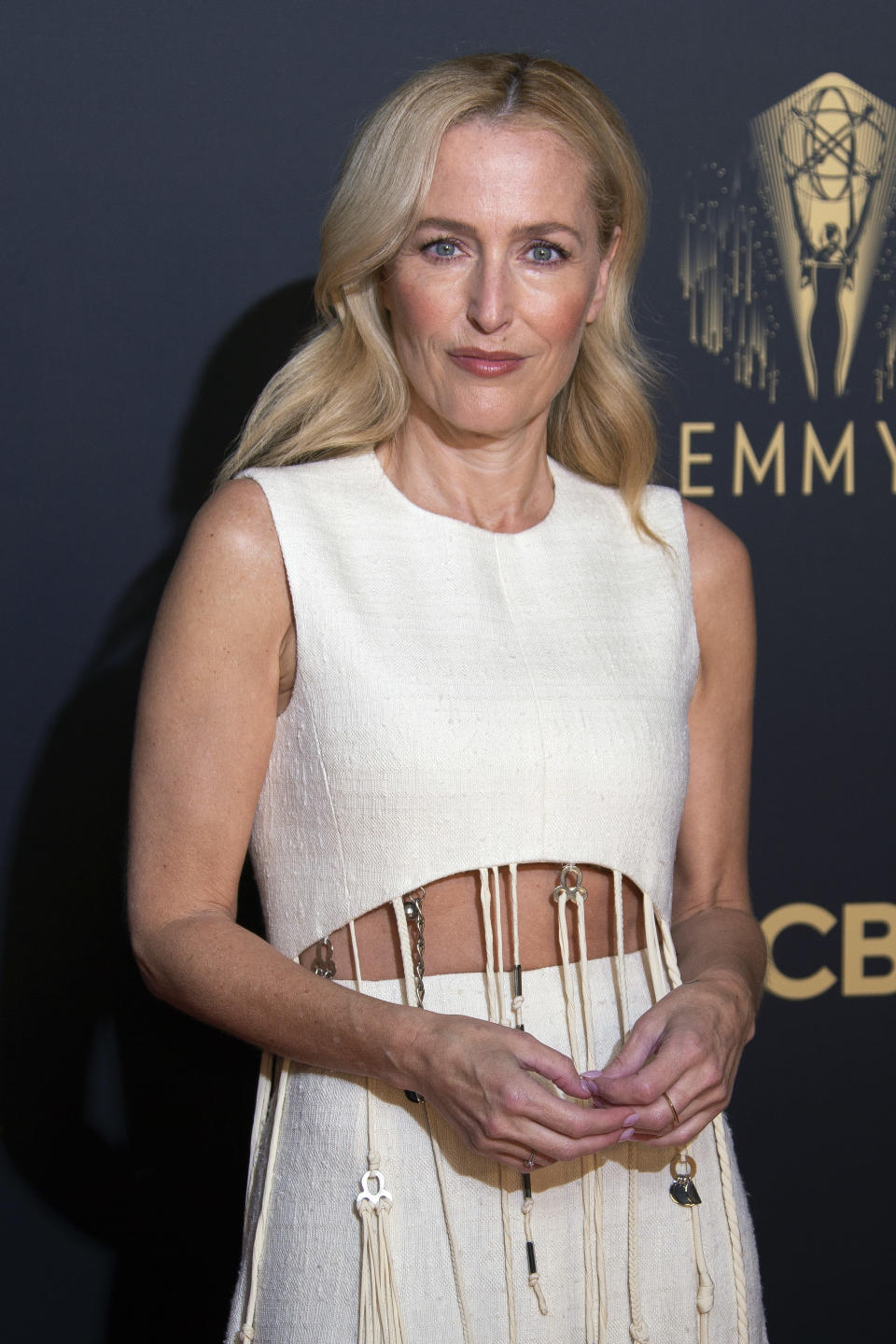 Gillian Anderson poses for photographers as she arrives for the Netflix Celebration of the 73rd Primetime Emmy Awards in central London, Sunday, Sept. 19, 2021. (Photo by Joel C Ryan/Invision/AP)