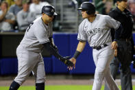 New York Yankees' Gary Sanchez, left, and Gio Urshela score on a single hit by Chris Gittens during the seventh inning of a baseball game against the Toronto Blue Jays, Thursday, June 17, 2021, in Buffalo, N.Y. (AP Photo/Jeffrey T. Barnes)
