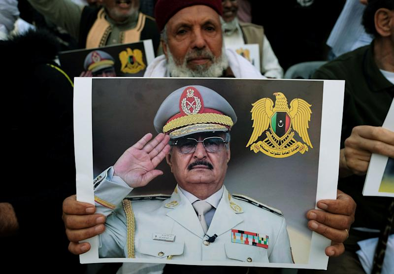 A Libyan man carries a picture of Khalifa Haftar during a demonstration to support Libyan National Army offensive against Tripoli, in Benghazi, Libya April 12, 2019. (Photo: Esam Omran Al-Fetori/Reuters)