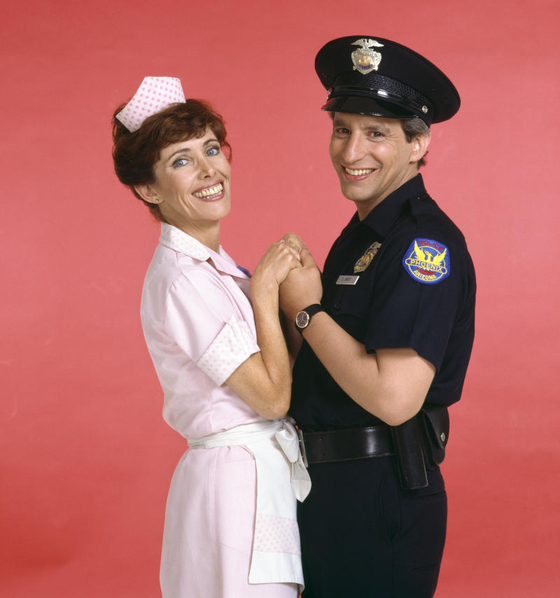 LOS ANGELES - JANUARY 1: Alice, a CBS television situation comedy, about characters who work and dine at Mel's Diner. January 1, 1983. Pictured is Beth Howland (as Vera Louise Gorman, waitress) and Charles Levin (as Elliot Novak, police officer). (Photo by CBS via Getty Images)