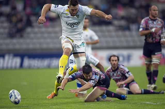Clermont's flanker Jamie Cudmore (L) vies with Stade Francais' winger Guillaume Bousses during the European Challenge Cup semi final rugby union match Stade Francais vs. Clermont at the Charlety stadium in Paris on April 29, 2011. AFP PHOTO / BERTRAND LANGLOIS (Photo credit should read BERTRAND LANGLOIS/AFP/Getty Images)