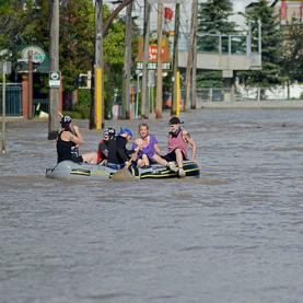 Calgarians rafting down what used to be a paved street. Photo credit: Wayne Stadler