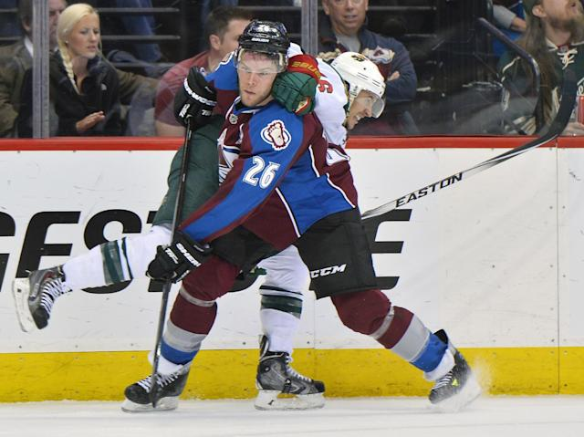 Colorado Avalanche center Paul Stastny (26) and Minnesota Wild defenseman Jared Spurgeon tangle in the second period during Game 7 of an NHL hockey first-round playoff series on Wednesday, April 30, 2014, in Denver. (AP Photo/Jack Dempsey)