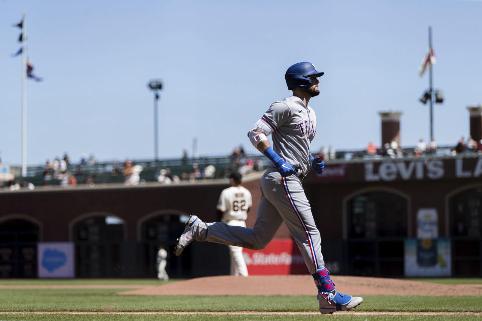 Texas Rangers' David Dahl runs the bases after hitting a solo home run against the San Francisco Giants during the seventh inning of a baseball game in San Francisco, Tuesday, May 11, 2021. (AP Photo/John Hefti)