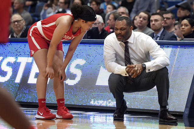 Houston head coach Ronald Hughey, right, talks with Houston's Dymond Gladney in the first half of an NCAA college basketball game against Connecticut, Saturday, Jan. 11, 2020, in Hartford, Conn. (AP Photo/Jessica Hill)