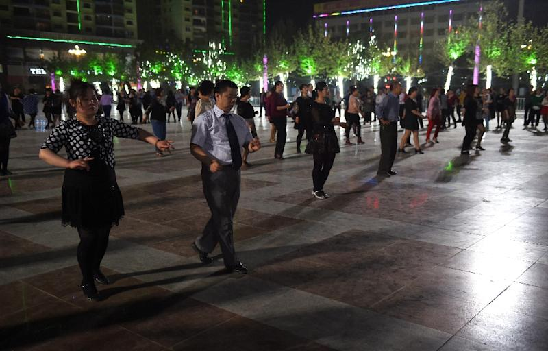 Han Chinese couples dance in a square in Hotan, in China's western Xinjiang region, April 15, 2015 (AFP Photo/Greg Baker)