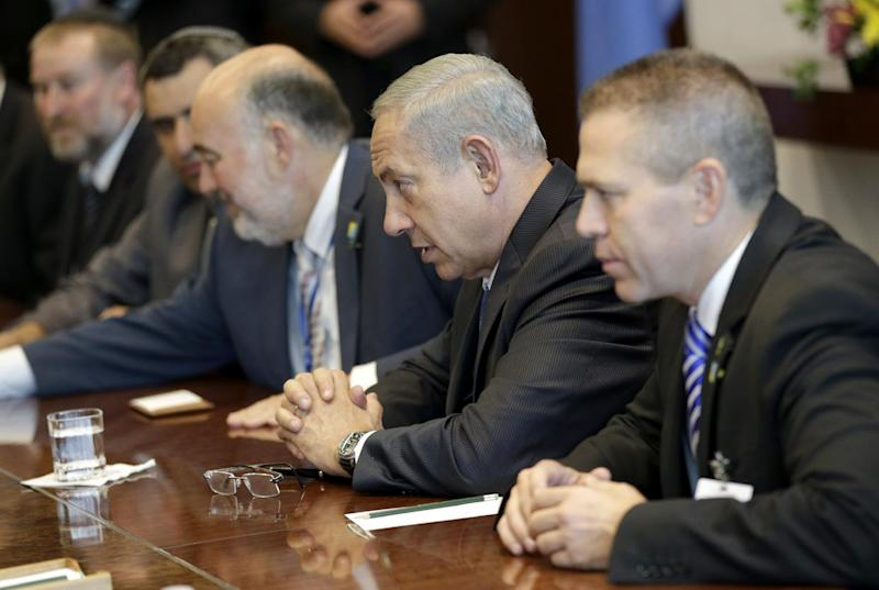 Israeli Prime Minister Benjamin Netanyahu, center, talks with United Nations Secretary-General Ban Ki-moon during the 68th session of the General Assembly at U.N. headquarters, Tuesday, Oct. 1, 2013. (AP Photo/Seth Wenig)