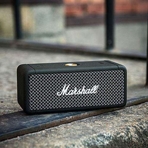 """<p><strong>Marshall</strong></p><p>amazon.com</p><p><strong>$149.99</strong></p><p><a href=""""https://www.amazon.com/dp/B08B951D35?tag=syn-yahoo-20&ascsubtag=%5Bartid%7C2089.g.1453%5Bsrc%7Cyahoo-us"""" rel=""""nofollow noopener"""" target=""""_blank"""" data-ylk=""""slk:Shop Now"""" class=""""link rapid-noclick-resp"""">Shop Now</a></p><p>The Marshall Emberton compact speaker has a characterful design, a fully waterproof build, and great sound. We also like its intuitive controls, and that it lasts 20 hours between charges. Dad's going to love the old-school look, too.</p>"""