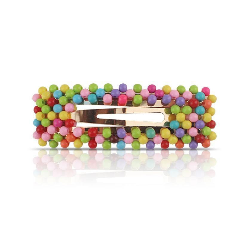 """<p>The tiny candy-like pieces that cover this Trademark Beauty Dots Clip look sweet enough to pop off and eat — but please don't. The oversized, colorful clip will look cute against any hair color, and it'll add some texture to your style if you're wearing a <a href=""""https://www.allure.com/story/at-home-blowout?utm_source=nl&utm_brand=allure&utm_mailing=ALL_CommBeauty_112520_BestHairDryers&utm_campaign=aud-dev&utm_medium=email&bxid=5ebb7389f8af0a114d1cd58b&cndid=61701331&hasha=052dc487736bac1af15481b4236ed5a2&hashb=423954408d87ae147bcbc66a38482d883858cbc8&hashc=f04bab07136afe440dc8377d02595ed3212b1839a810cbaaf7ac53abedc380be&esrc=subscribe-page&utm_content=A&utm_term=ALL_Ecomm_Beauty&mbid=synd_yahoo_rss"""" rel=""""nofollow noopener"""" target=""""_blank"""" data-ylk=""""slk:smooth blowout"""" class=""""link rapid-noclick-resp"""">smooth blowout</a>.</p> <p><strong>$5</strong> (<a href=""""https://cna.st/affiliate-link/428C3oXt3BApcLQifaXeiXDJobJ7q9wkNSTk2n7UjBcbXAtzUZmmYFJsZx9RLJfdKkBhm8R17ECPdxjG3Yghth1pW1ukFBQ9EcxXNJb7W9CiQeXYXaQhStYPcM3ccijWRthSxrrXFcwEF?cid=601d6582fb754078af0e3d9b"""" rel=""""nofollow noopener"""" target=""""_blank"""" data-ylk=""""slk:Shop Now"""" class=""""link rapid-noclick-resp"""">Shop Now</a>)</p>"""