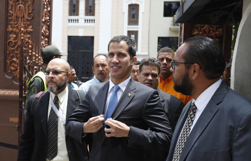 National Assembly President Juan Guaido, who declared himself interim president of Venezuela, adjusts his blazer as he arrives to lead a session of the opposition-controlled assembly in Caracas, Venezuela, Monday, March 11, 2019. The U.S.-backed leader of the National Assembly has blamed the blackouts that began Thursday on alleged government corruption and mismanagement. (AP Photo/Eduardo Verdugo)