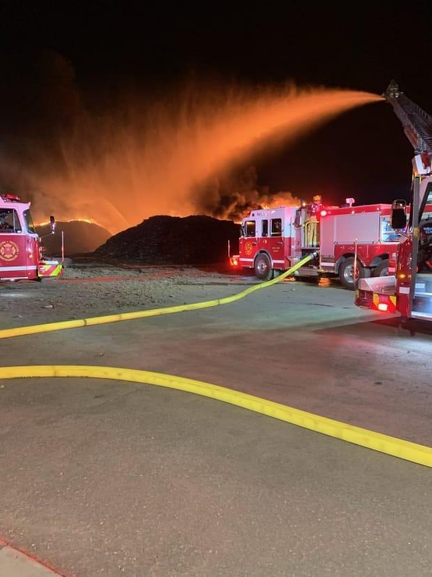 The Regina Fire Department spent the night fighting a fire at a compound north of Evraz Steel. (Twitter/Regina Fire Department - image credit)