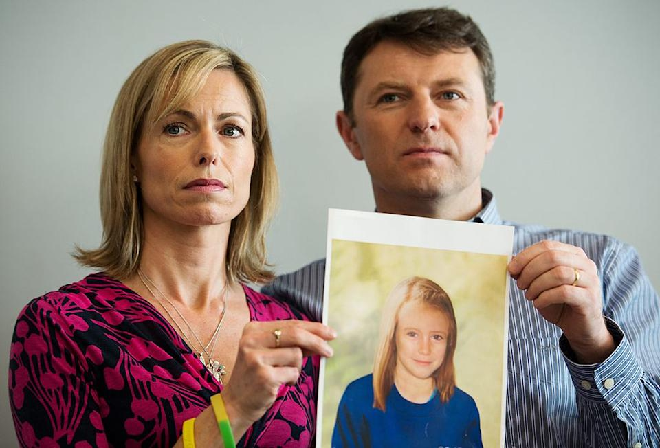 Parents of missing girl Madeleine McCann, Kate (L) and Gerry McCann (R) pose with an artist's impression of how their daughter might look now at the age of nine ahead of a press conference in central London, 2012 five years after Madeleine's disappearance while on a family holiday in Portugal.