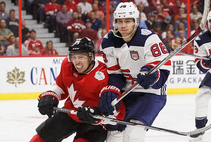 OTTAWA, ON - SEPT 10: Logan Couture #39 of Team Canada and Brent Burns #88 of Team USA battle for position during a World Cup of Hockey 2016 Pre-Tournament game at Canadian Tire Centre on September 10, 2016 in Ottawa, Ontario, Canada. (Photo by Andre Ringuette/World Cup of Hockey via Getty Images)