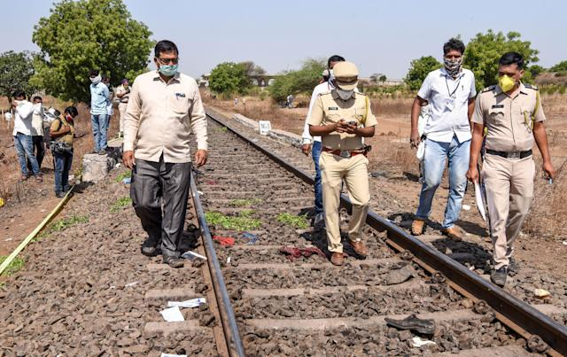Officials walk on a rail track as they check the site following a train accident with migrant labourers near Aurangabad on May 8, 2020.