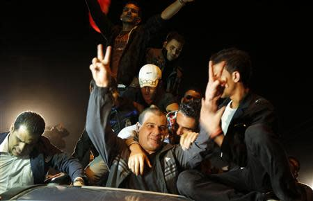 A released Palestinian prisoner reacts upon his arrival at the Erez crossing between Israel and the northern Gaza Strip