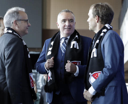 Ian Ayre, center, talks with Mayor David Briley, left, and John Ingram, right, after Ayre was introduced as the first chief executive officer of the Nashville MLS franchise Monday, May 21, 2018, in Nashville, Tenn. Ayre is a former CEO of the Liverpool Football Club of the English Premier League. Ingram is the lead owner the Nashville franchise. (AP Photo/Mark Humphrey)