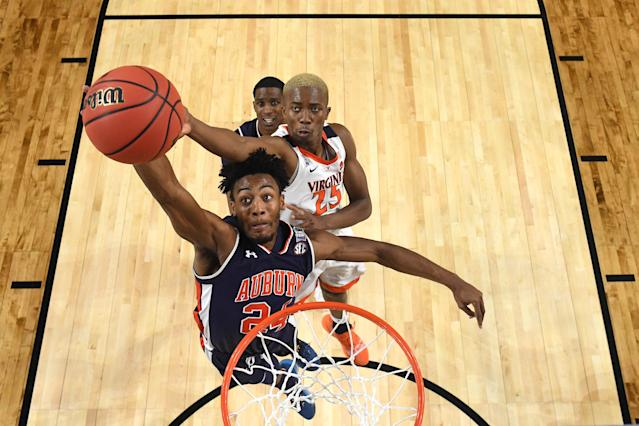 Anfernee McLemore #24 of the Auburn Tigers shoots against Mamadi Diakite #25 of the Virginia Cavaliers during the first half of the semifinal game in the NCAA Men's Final Four at U.S. Bank Stadium on April 06, 2019 in Minneapolis, Minnesota. (Photo by Brett Wilhelm/NCAA Photos via Getty Images)